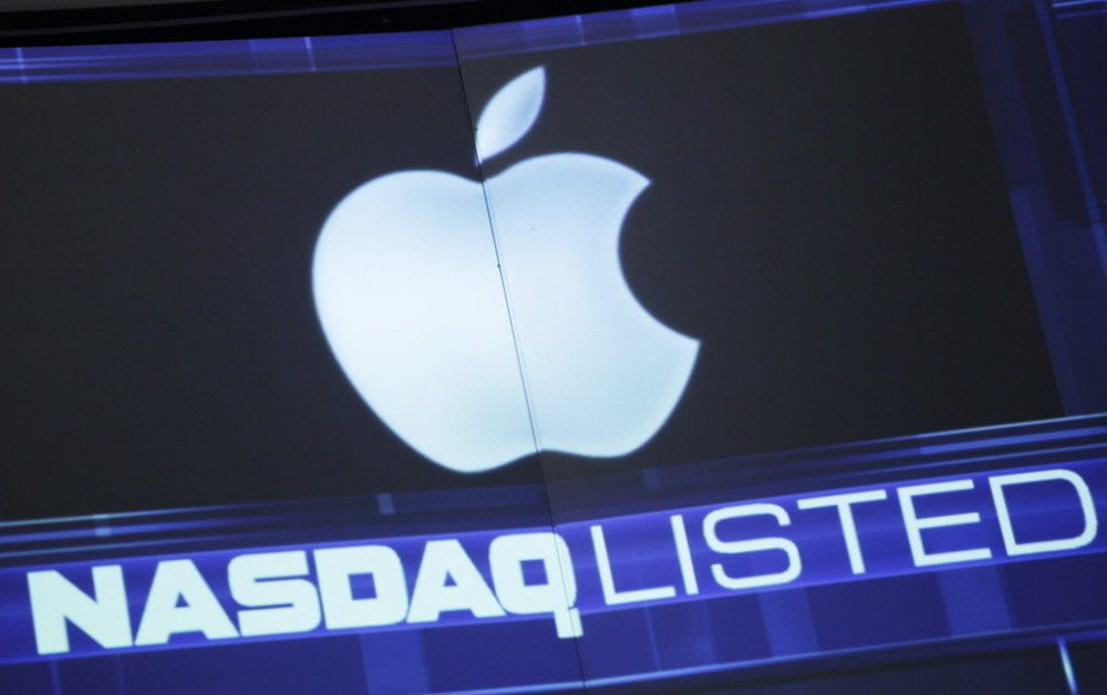 FILE - This Tuesday, Aug. 21, 2012, file photo shows the Apple logo on a stock ticker at the Nasdaq MarketSite, in New York. Apple's market value has surged to over $750 billion from $22.5 billion in March 2000. The maker of iPhones and iPads accounts for 10 percent of the Nasdaq's market value. (AP Photo/Mark Lennihan, File) ORG XMIT: NYBZ155